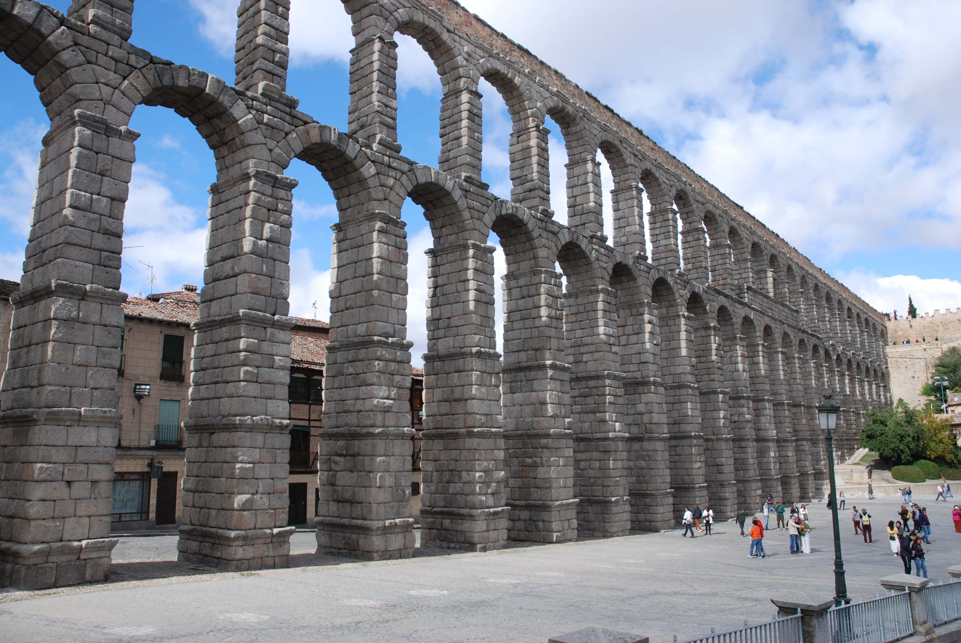 Cycle through the impressive Roman aqueduct at Segovia